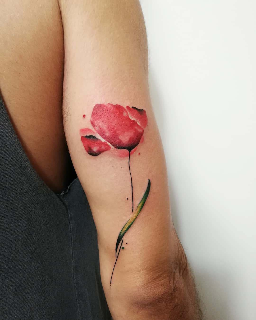 poppy tattoo on arm