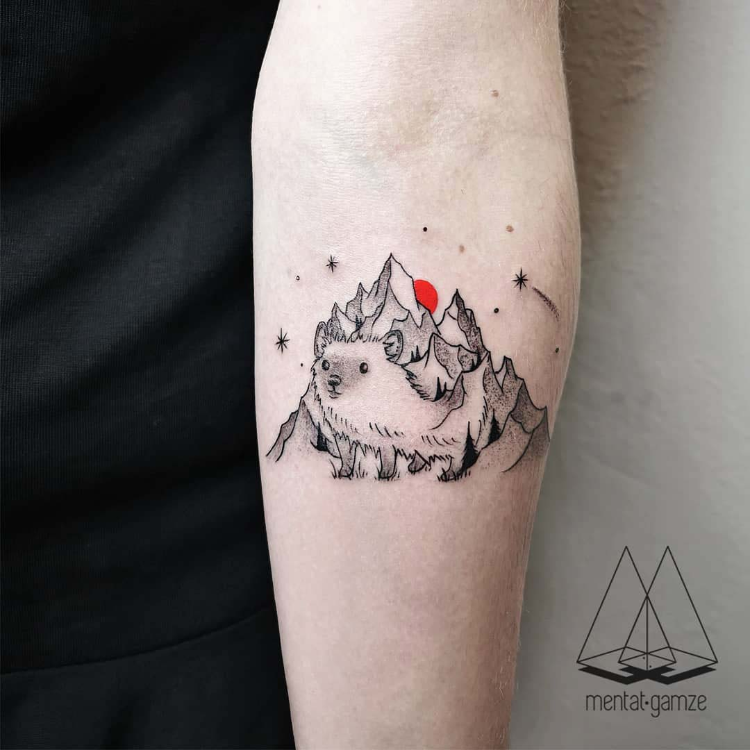 arm tattoo hedgehog mountains
