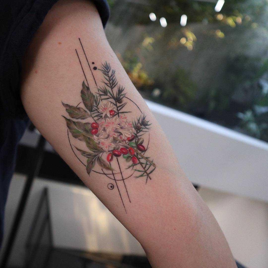 arm tattoo berries