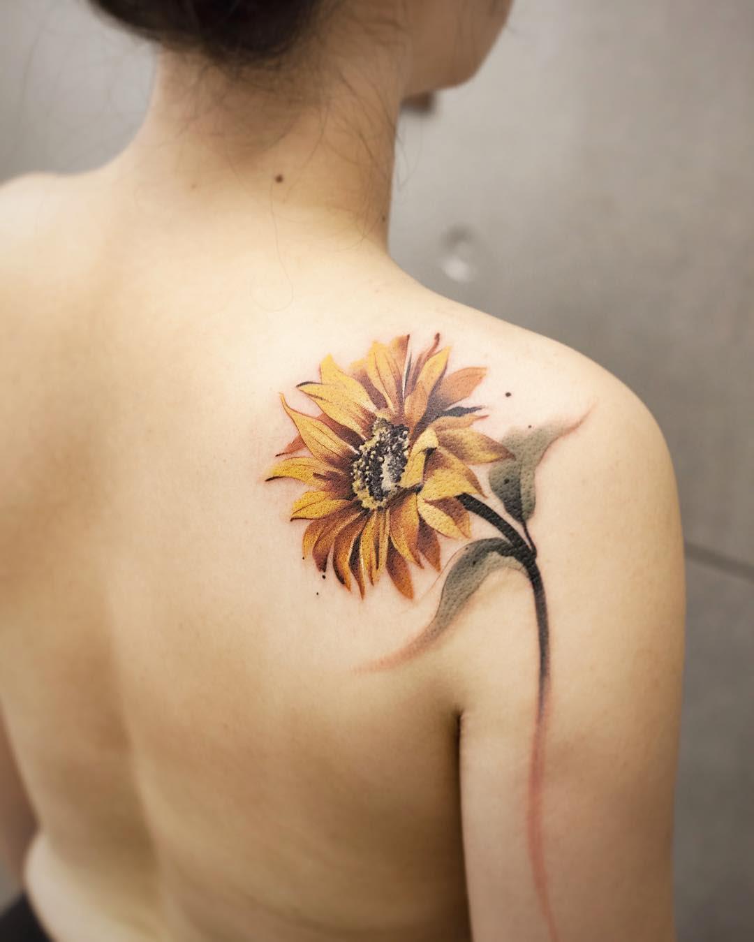 shoulder blade tattoo sunflower