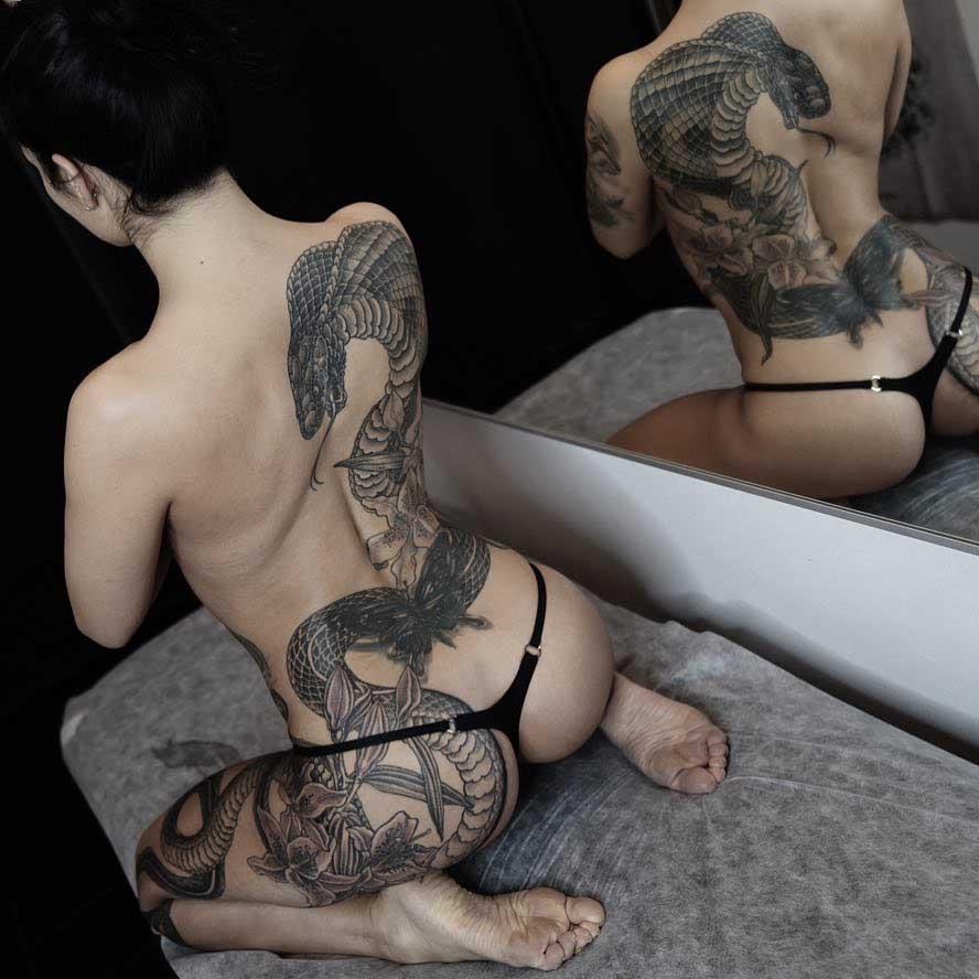 big snake tattoo on back and hip