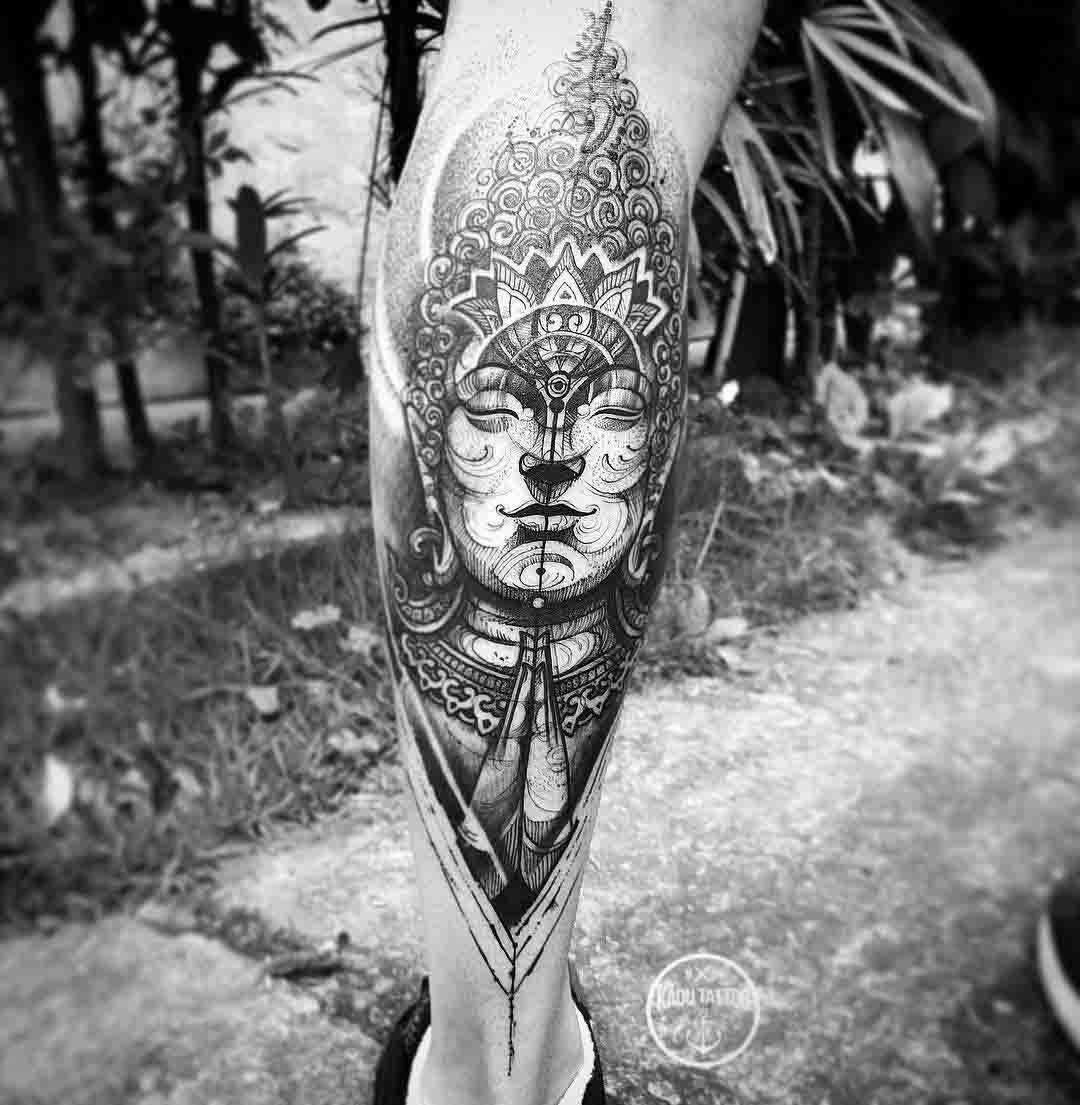 calf tattoo buddha