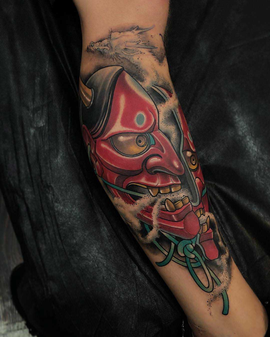 hannya mask tattoo on arm